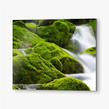 Bilder auf Alu-Dibond Ein wunderschöner fließender Wasserfall zwischen den Steinen
