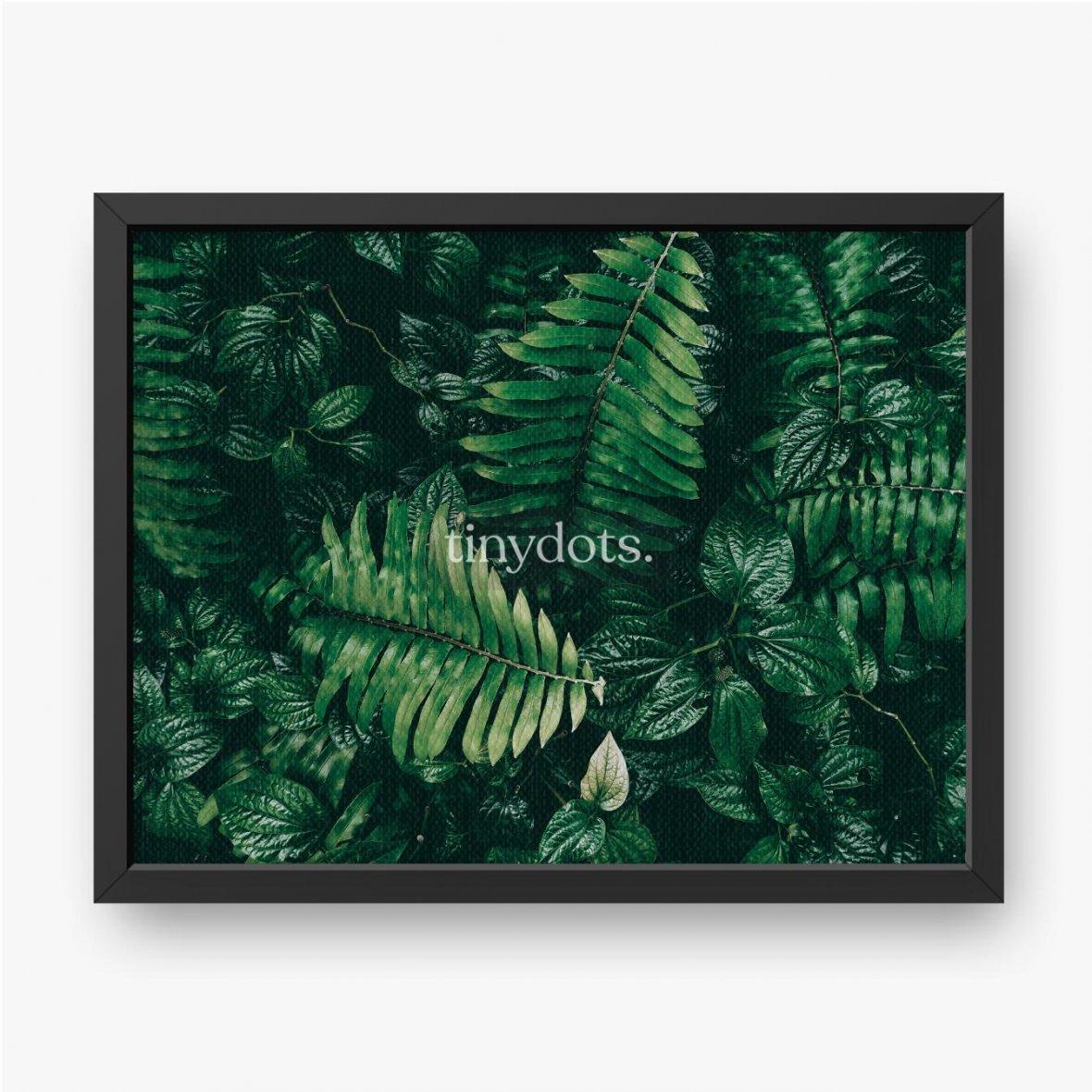 Gerahmte Leinwandbilder Tropisches grünes Blatt im dunklen Ton.